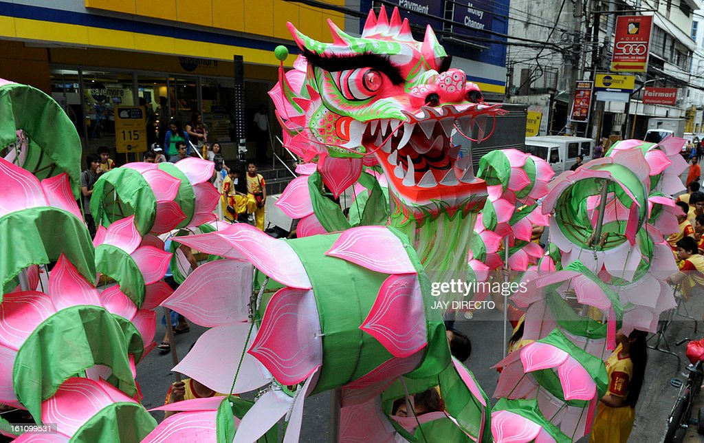 Performers take part in a dragon dance on the eve of the Chinese Lunar New Year of the Snake, in China town in Manila on February 9, 2013. The Dragon Dance is usually performed during the Chinese New Year to bring in good luck and prosperity as billions of Chinese world wide celebrate Lunar New Year of the Snake on February 10. AFP PHOTO / Jay DIRECTO