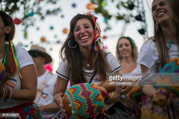 Performers take part in a Festa Junina party at Paris Square in Gloria neighborhood in Rio de Janeiro Brazil on July 15 2017 Annually Brazilians...