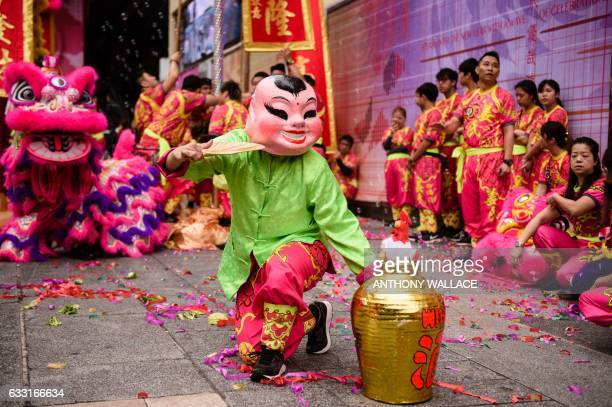 Performers take part in a lion dance show as part of the Lunar New Year celebrations of the Year of the Rooster in Hong Kong on January 31 2017 The...