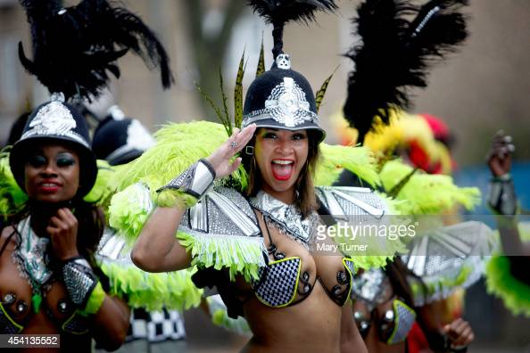 Performers take part in a rain soaked Notting Hill Carnival on August 25th 2014 in London England Despite the bad weather over 1 million visitors are...