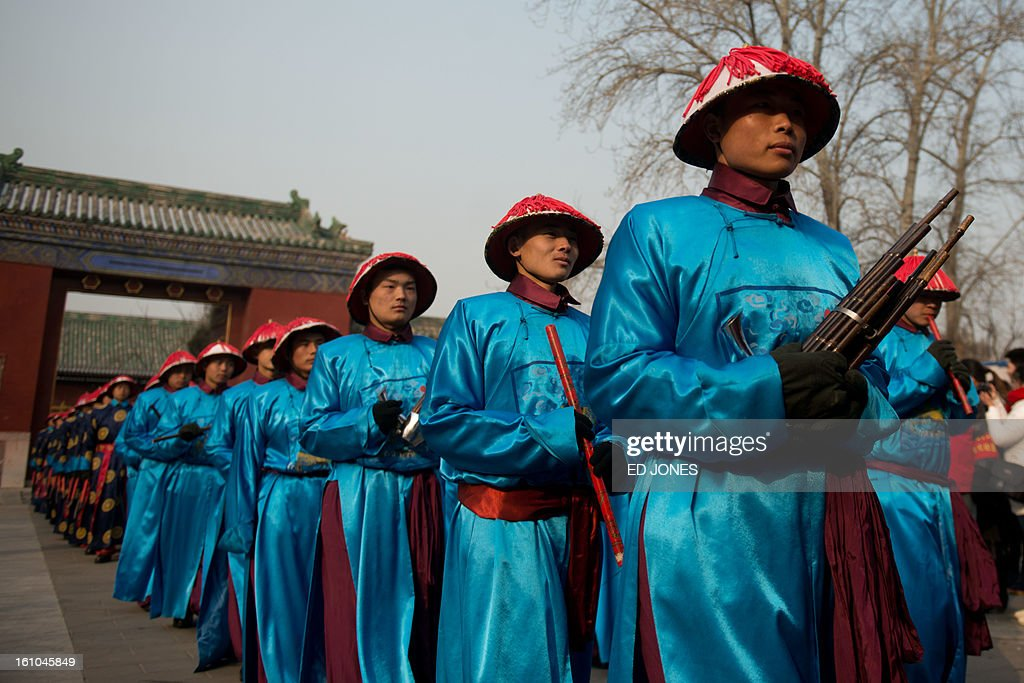 Performers take part in a traditional Qing Dynasty ceremony in which emperors prayed for good fortune, during the opening of an annual fair at the Temple of Earth park in Beijing on February 9, 2013 a day before the Lunar New Year. China is preparing to welcome the lunar new year of the snake which falls on Febraury 10. AFP PHOTO / Ed Jones