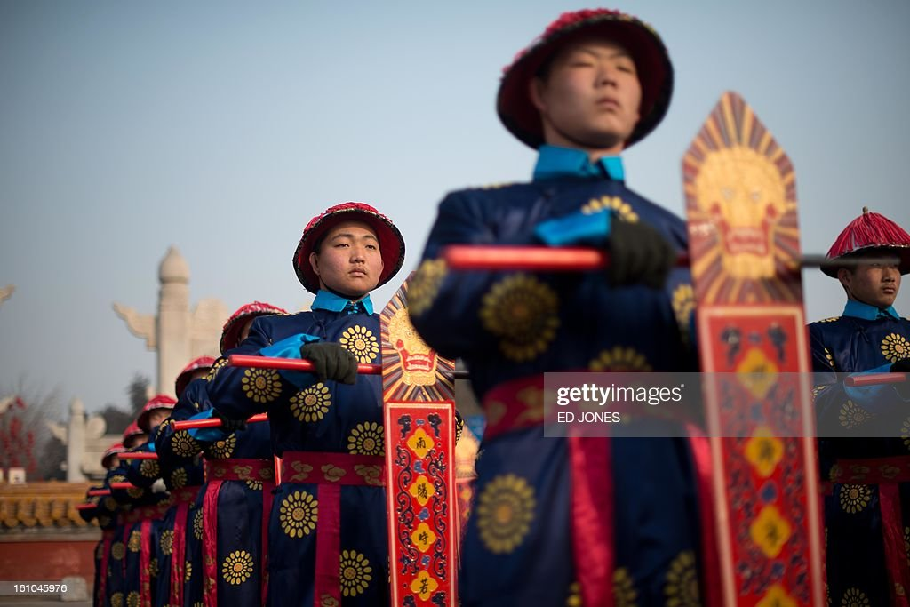 Performers take part in a traditional Qing Dynasty ceremony in which emperors prayed for good fortune, during the opening of an annual fair at the Temple of Earth park in Beijing on February 9, 2013, a day before the Lunar New Year. China is preparing to welcome the lunar new year of the snake which falls on Febraury 10. AFP PHOTO / Ed Jones