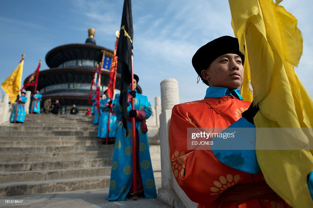 Performers take part in a traditional Qing Dynasty ceremony in which emperors prayed for good fortune, during lunar new year festivities at the temple of Heaven in Beijing on February 10, 2013. A billion-plus Asians ushered in the Year of the Snake with a cacophony of fireworks and ceremonies to kick off a week of festivities. AFP PHOTO / Ed Jones