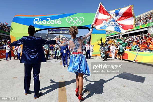 Performers take part in festivities during the Women's Marathon on Day 9 of the Rio 2016 Olympic Games at the Sambodromo on August 14 2016 in Rio de...