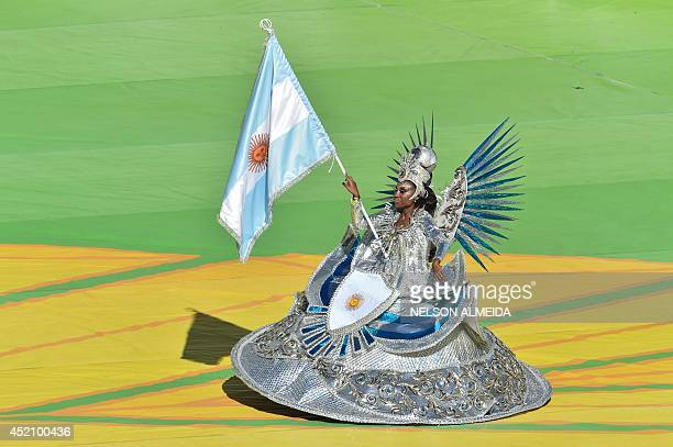 Performers take part in the closing cermony prior to the 2014 FIFA World Cup final football match between Germany and Argentina at the Maracana...