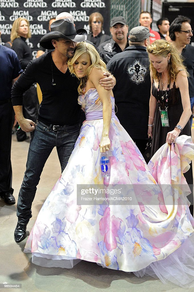 Performers <a gi-track='captionPersonalityLinkClicked' href=/galleries/search?phrase=Tim+McGraw&family=editorial&specificpeople=202845 ng-click='$event.stopPropagation()'>Tim McGraw</a> and <a gi-track='captionPersonalityLinkClicked' href=/galleries/search?phrase=Carrie+Underwood&family=editorial&specificpeople=204483 ng-click='$event.stopPropagation()'>Carrie Underwood</a> hug backstage at the 45th Annual Academy of Country Music Awards at the MGM Grand Garden Arena on April 18, 2010 in Las Vegas, Nevada.