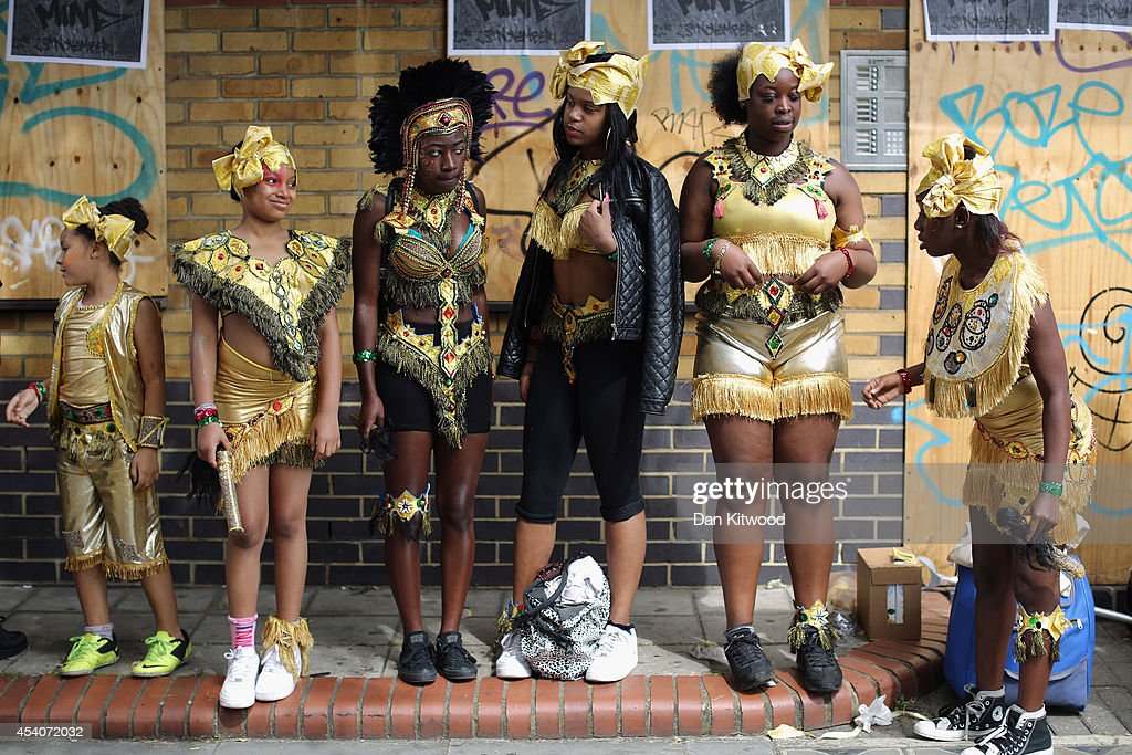Performers wait their turn to join the procession parade through the streets during the Notting Hill Carnival on August 24, 2014 in London, England. The Notting Hill Carnival is the largest street festival in Europe and was first held in 1964 by the Afro-Caribbean community. Over the bank holiday weekend the streets come alive to steel bands, colourful floats and costumed performers as members of the public flood into the area to join in the celebrations.