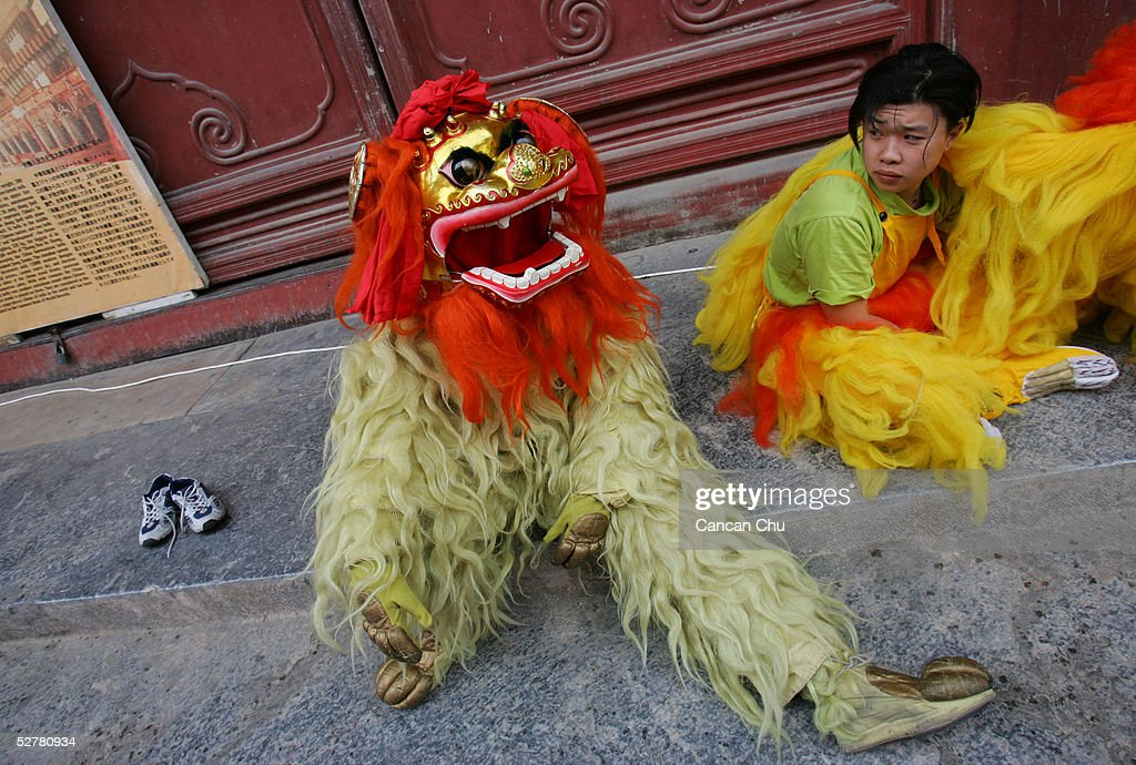Performers wait to play lion dance for a ceremony on May 10, 2005 in Beijing, China.