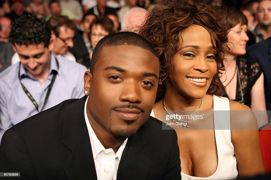 Performers Whitney Houston and Ray-J sit ringside for the Joe Calzaghe of Wales and Bernard Hopkins light heavyweight bout at Thomas & Mack Center on April 19, 2008 in Las Vegas, Nevada.