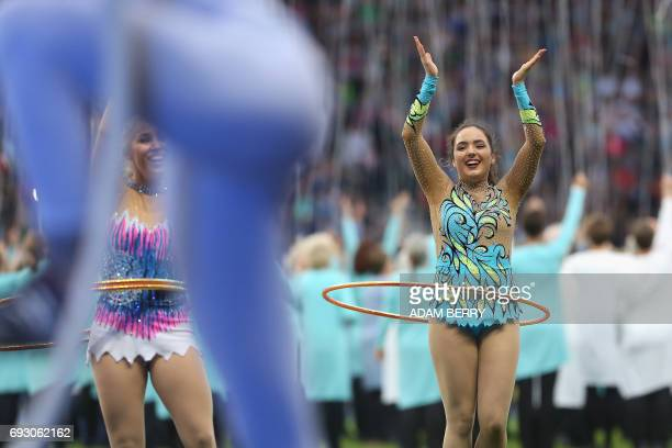 Performers with hula hoops show their acts at the Stadium Gala of the 2017 Deutsches Turnfest at the Olympic Stadium in Berlin on June 6 2017 / AFP...