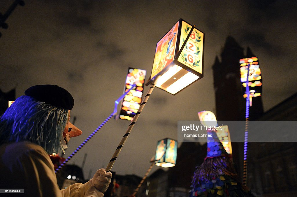 Performers with typical masks and lanterns take part in the traditional 'Morgestraich' for the opening of the Basel Fasnacht Carnival on February 18, 2013 in Basel, Switzerland. More than 12,000 participants will take part in the largest carnival in Switzerland that lasts for 72 hours and will be watched by more than 100,000 spectators as it makes its way through the city center.