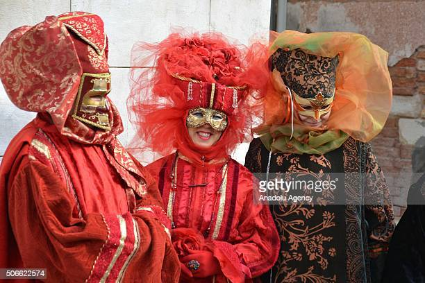 Performers worn masks and interesting costumes pose near the Cannaregio Canal for the Carnival Regatta during the Venice Carnival on January 24 2016...