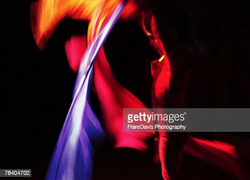 Performing artist with colorful cloth : Stock Photo