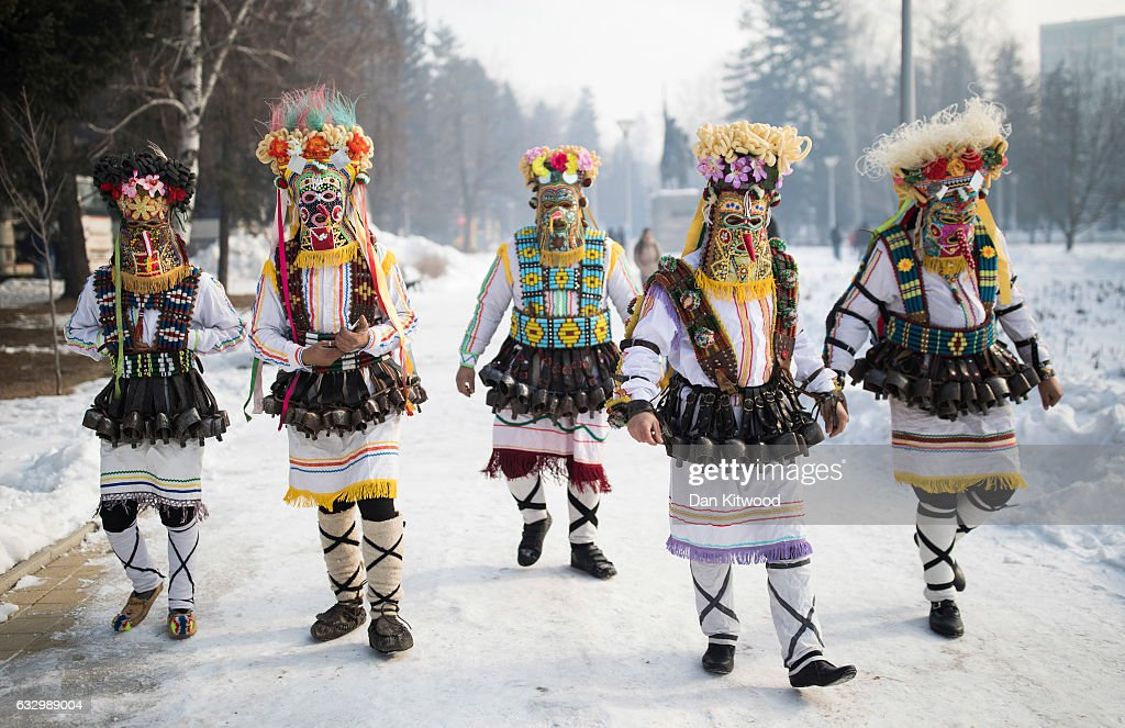 Performing 'Mummers' arrive at the start of the second and final day of the annual Surva International Festival of the Masquerade Games on January 29, 2017 in Pernik, Bulgaria. The two day Surva festival is the largest traditional folklore events of this type across the whole Balkan Peninsula. Around 6000 people from every folklore region of Bulgaria, participate in the pagan event which sees masked Kukers, (mummers) and Survakari dancers, as well as costumed pagan dancers from across the wider region parade through the city streets. The Kukeri tradition is included in UNESCOÕs list of protected non-material cultural heritage.