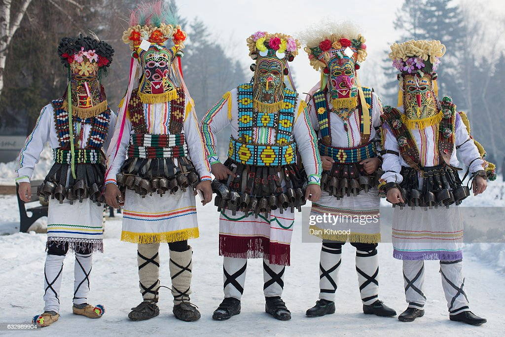 Performing 'Mummers' pose for a photograph at the start of the second and final day of the annual Surva International Festival of the Masquerade Games on January 29, 2017 in Pernik, Bulgaria. The two day Surva festival is the largest traditional folklore events of this type across the whole Balkan Peninsula. Around 6000 people from every folklore region of Bulgaria, participate in the pagan event which sees masked Kukers, (mummers) and Survakari dancers, as well as costumed pagan dancers from across the wider region parade through the city streets. The Kukeri tradition is included in UNESCOÕs list of protected non-material cultural heritage.