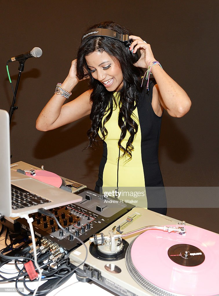 A DJ performs at the grand opening of the Audi and Volkswagen Manhattan dealership on May 10, 2013 in New York City.
