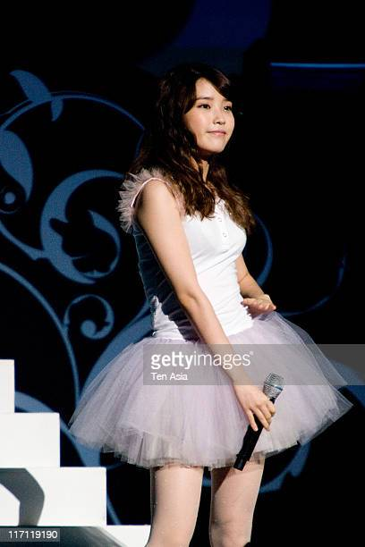 IU performs during the fan meeting at AXKOREA in June 18 2011 in Seoul South Korea