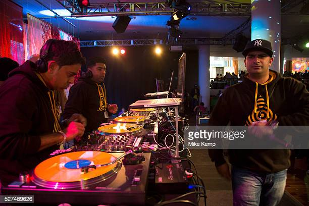 DJ performs for people dancing to Asian music during Alchemy Southbank Centre's annual festival showcasing the best of music dance literature comedy...
