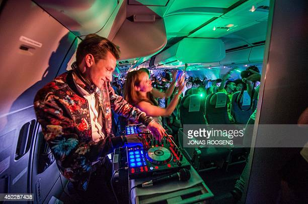 A DJ performs in a plane on July 16 2014 ahead of the Tomorrowland music festival at De Schorre in Boom starting on July 18 AFP PHOTO / BELGA / JONAS...