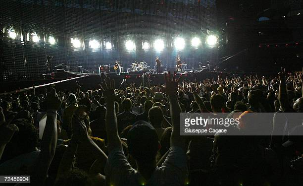 U2 performs on stage during their Vertigo Tour 2005 at the San Siro Stadium on July 20 2005 in Milan Italy