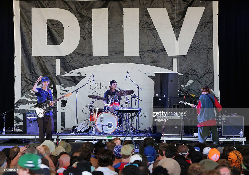 DIIV performs onstage during day 2 of the 2013 Bonnaroo Music Arts Festival on June 14 2013 in Manchester Tennessee