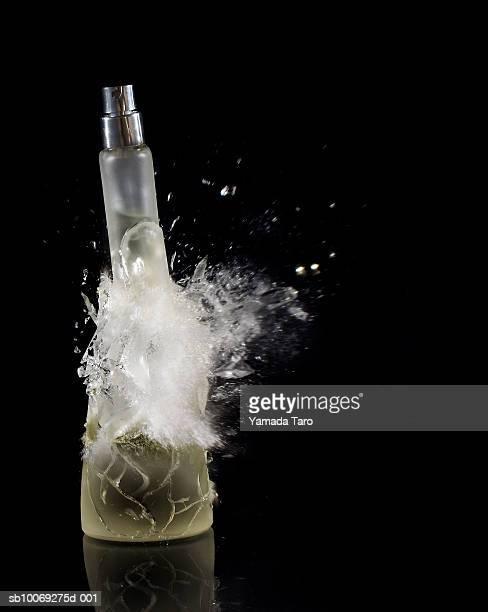 Perfume bottle exploding, close-up