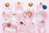 Perfume bottles on pink background