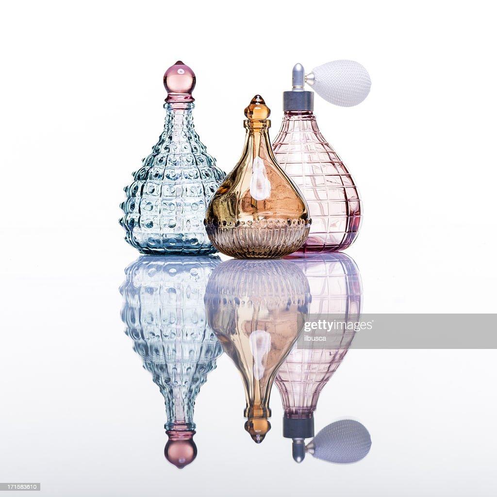 Perfume bottles studio shot on white with reflection