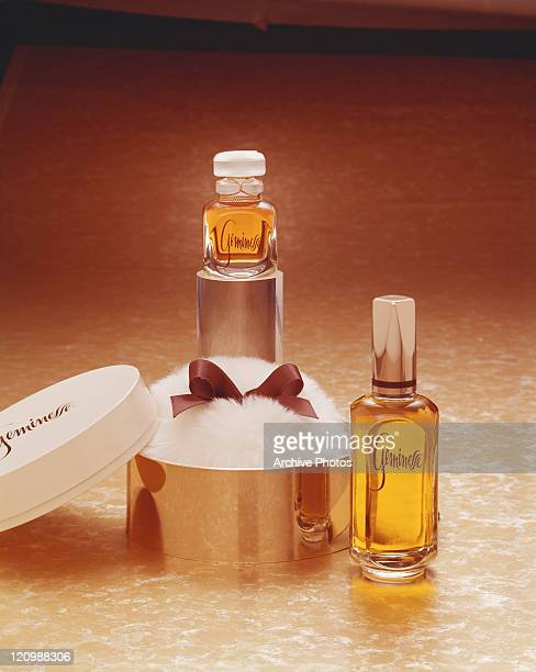 Perfume bottles with powder puff, close-up