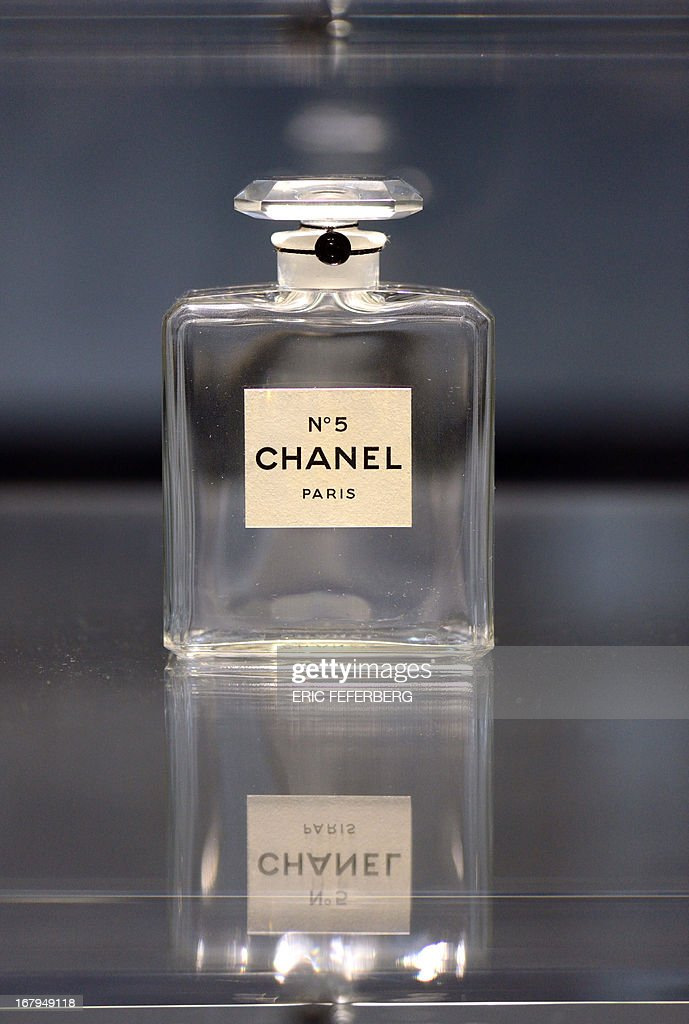 A perfume flask of 'Chanel N°5', created in 1921, is displayed as part of the exhibition 'N°5 culture Chanel' referring to French fashion designer Coco Chanel (1883-1971) at the Palais de Tokyo art museum in Paris, on May 3, 2013. The exhibition runs from May 5 to June 5, 2013.