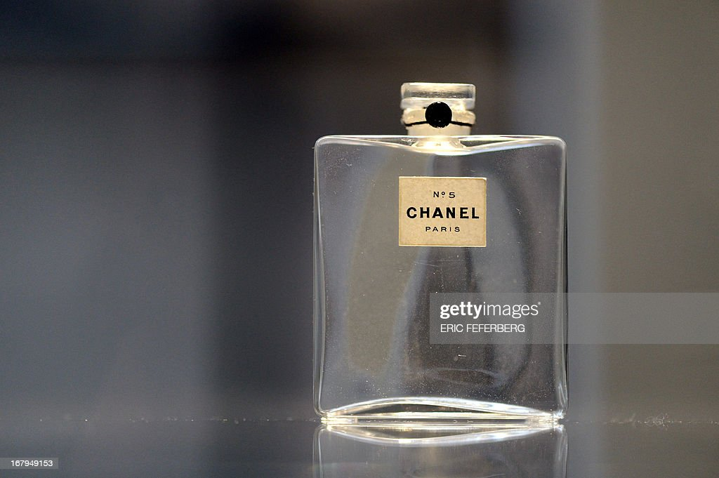 A perfume flask of 'Chanel N°5', created in 1921, is displayed as part of the exhibition 'N°5 culture Chanel' referring to French fashion designer Coco Chanel (1883-1971) at the Palais de Tokyo art museum in Paris, on May 3, 2013. The exhibition runs from May 5 to June 5, 2013. AFP PHOTO / ERIC FEFERBERG CAPTION193
