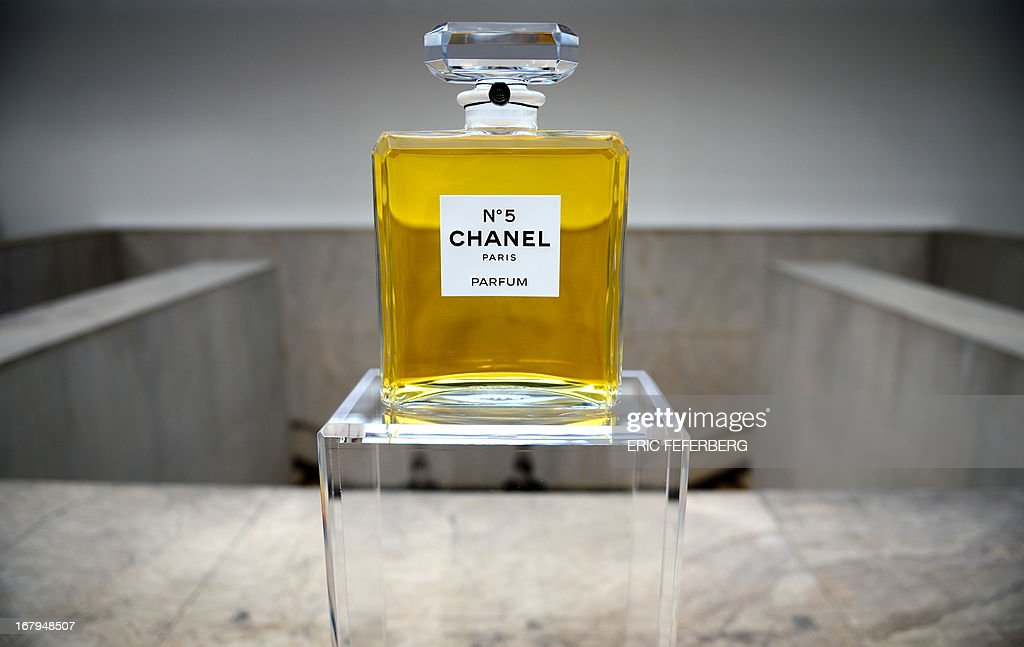 A perfume flask of 'Chanel N°5' is displayed as part of the exhibition 'N°5 culture Chanel' at the Palais de Tokyo in Paris on May 3, 2013. AFP PHOTO / ERIC FEFERBERG