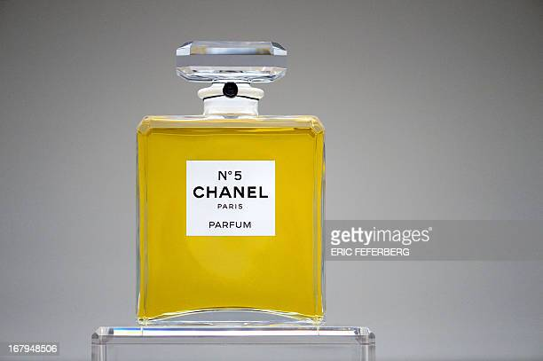 A perfume flask of 'Chanel N°5' is displayed at Tokyo palace exhibition on May 3 2013 in Paris AFP PHOTO / ERIC FEFERBERG