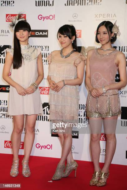 Perfume poses for photographs on the red carpet of the MTV Video Music Awards Japan 2012 at Makuhari Messe on June 23 2012 in Chiba Japan