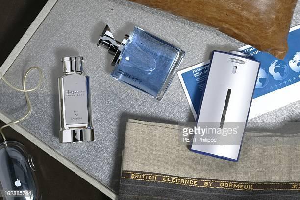 Perfumes For Men Les parfums pour hommes le businessman flacons de parfums BALDESSARINI d'Hugo BOSS DUNHILL XCENTRIC FACONNABLE HOMME sur un plateau...