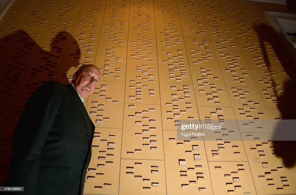 Pergrine Cavendish, Duke of Devonshire poses for a photogragh between panels of ceramic blocks which represent his DNA, by artist Jacob Van der Beugel, which is now a permanent fixture at Chatsworth House on March 12, 2014 in Chatsworth, England. Chatsworth House reopens after a winter break on Sunday 16th March