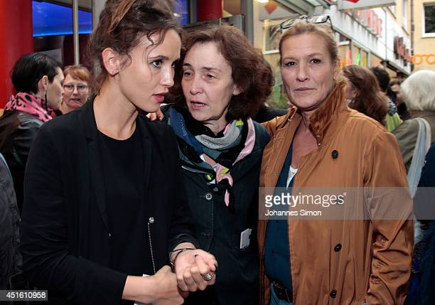 Peri Baumeister Hermine Huntgeburth and Suzanne von Borsody attend the 'Maennertreu' premiere as part of Filmfest Muenchen 2014 at Rio Filmpalast on...