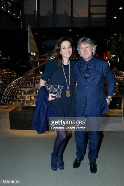 Peri Cochin and her husband Andrea Zanconato pose in front the works of JeanPaul Goude during the 'Societe des Amis du Musee d'Art Moderne du Centre...