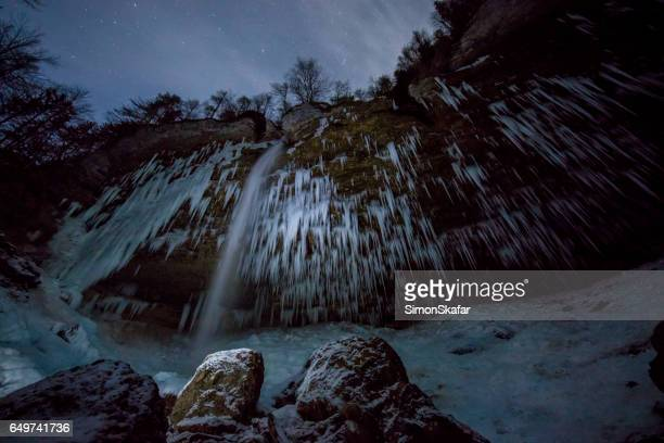 Pericnik Falls surrounded by icicles at Slovenia