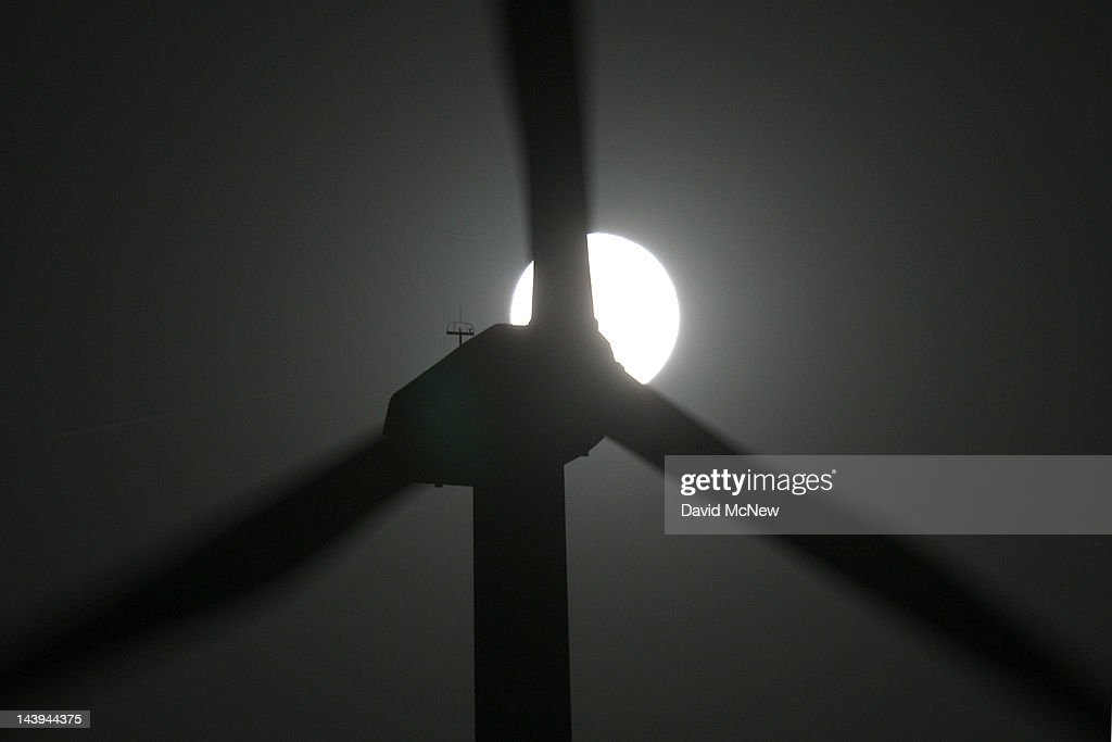 A perigee moon, or supermoon, rises behind wind turbines on May 5, 2012 near Palm Springs, California. The moon appears especially big and bright during this once-a-year cosmic event as the full moon is at its closest to the Earth in its elliptical orbit. The perigee side of its orbit is about 31,000 miles closer than the opposite, or apogee, side. The bright light of the full moon also hides all but the brightest meteors of the Eta Aquarid meteor shower, the remnant debris trail of Halley's Comet.