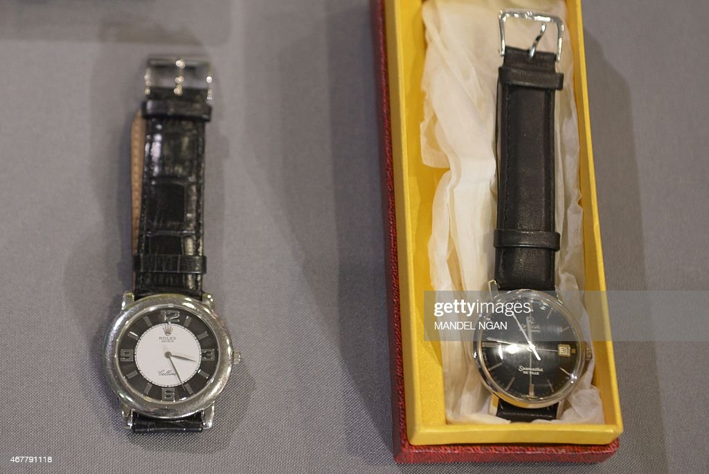 period consumer items including a rolex and omega watch from the period consumer items including a rolex and omega watch from the amc television series mad men are seen on display during an event to present the