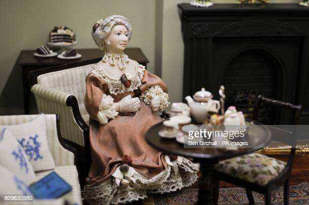 A period dressed doll by Ann Lucas who has been making dolls for over 25 years in her own studio sits dow to teaPicture date Thursday September 2011...