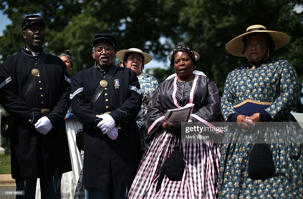 Period Re-enactors attend an event at the gravesite of Buffalo Soldier Col. Charles Young, at Arlington Cemetery, June 5, 2013 in Arlington, Virginia. The event was hosted by the National Coalition of Black Veterans and the Omega Psi Phi Fraternity to celebrate the 90th anniversary of 'Buffalo Soldier' and military leader Col. Charles Young's internment in Arlington Cemetery.