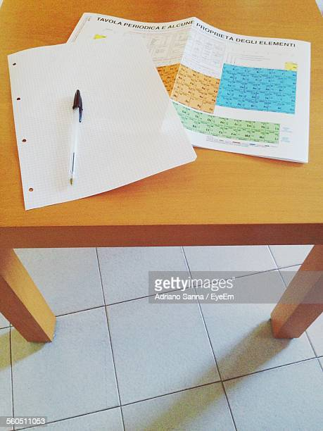 Periodic Chart With Pen And Blank Paper On Table