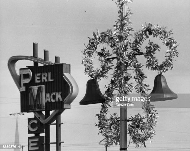 Perl Mack Shopping Center has lights on its lights The silver garlands and the bells on the poles are strung with lights that give off a Christmas...