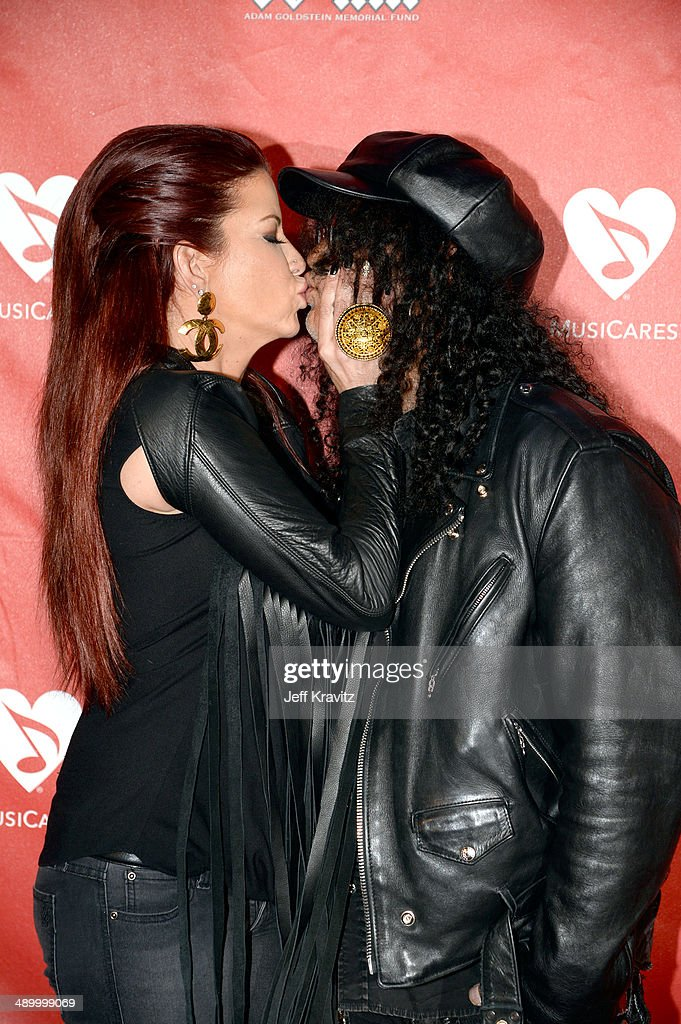 Perla Hudson and Slash arrives at Club Nokia on May 12, 2014 in Los Angeles, California.