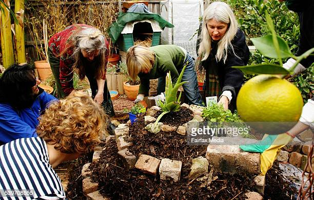 Permaculture students build a herb spiral under the instruction of Penny Pyett at the Permaculture class at the Sustainable Design Centre in Curl...