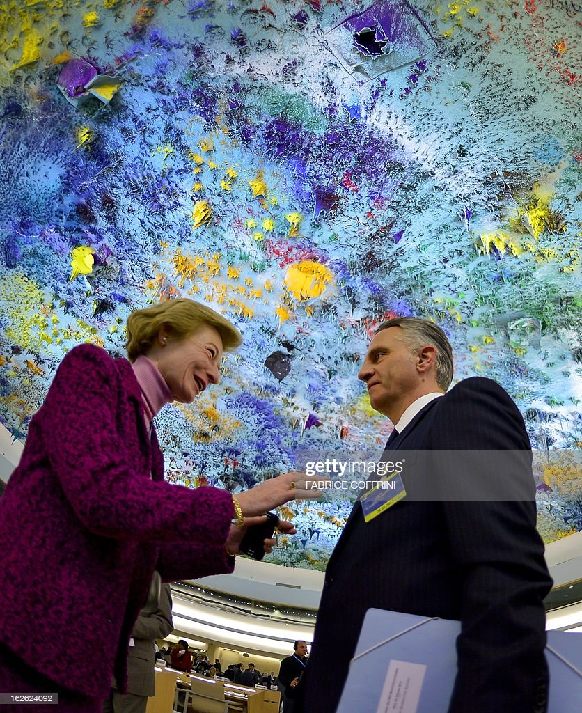 Permanent Observer of the Sovereign Military Order of Malta to the United Nations, Marie-Therese Pictet-Althann (L) speaks with Swiss Foreign Minister Didier Burkhalter at the opening of the 22nd session of the UN Human Rights Council on February 25, 2013 in Geneva. The Council kicks off with widespread abuses in North Korea and Mali the top items on the agenda, along with the crisis in Syria.