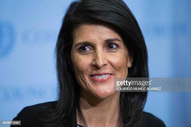 US Permanent Representative to the United Nations Ambassador Nikki Haley smiles as she speaks to the media after taking part in the UN Security...