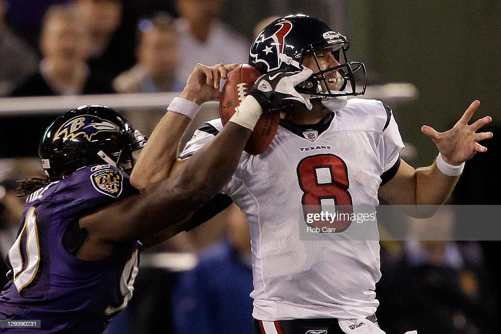 Pernell McPhee #90 of the Baltimore Ravens knocks the ball out of the hands of quarterback Matt Schaub #8 of the Houston Texans during the second half at M&T Bank Stadium on October 16, 2011 in Baltimore, Maryland.